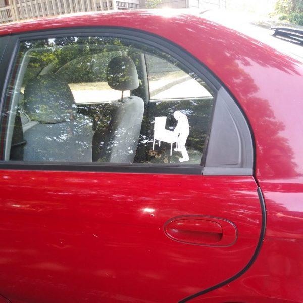 The Bigfoot Playing Pinball Decal on a Car